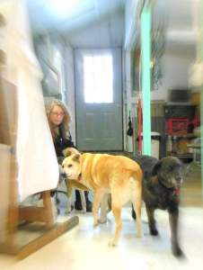 Elizabeth Lisa Petrulis in her studio with dogs Mookie and Dino.