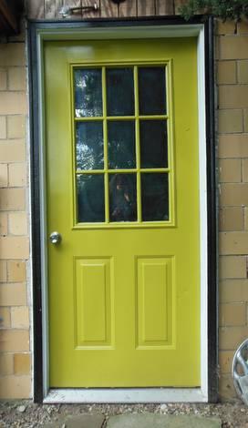 light yelowing green door with black trim, studio door