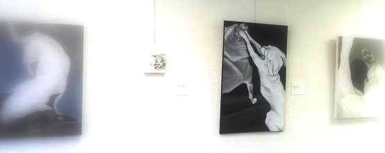 exhibition installation view featuring the acrylic on canvas painting Chihuahua Legs