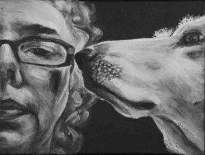 Intimate close up portrait in Black and white. Shows half womans face with glasses looking forward with dog in profile snout touching glasses.