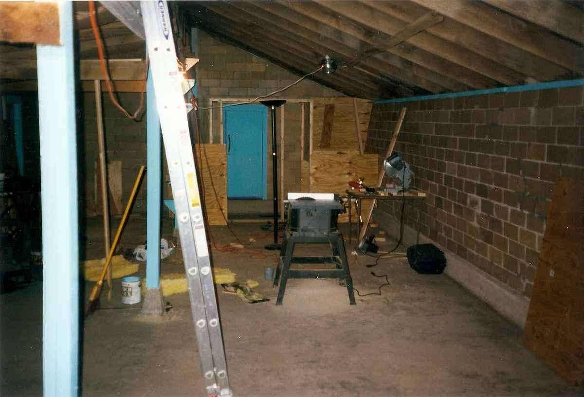 The Chicken house studio floor now cleaned up and renovations beginning. A door in place, a table saw, ladder and other evidence of work.