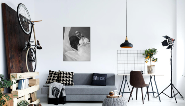 painting of play fighting dogs hung in living room